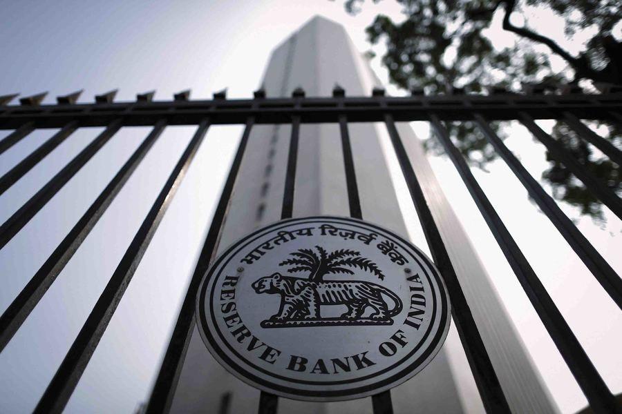A view of the Reserve Bank of India (RBI) seal on a gate outside the RBI headquarters in Mumbai in this October 29, 2013 file photo. The bold monetary experiment that the Chinese and Indian central banks engaged in this year might one day be hailed as a success. So far, the result has been unprecedented market volatility and little else. To match story ASIA-ECONOMY/POLICY REUTERS/Danish Siddiqui/Files (INDIA - Tags: BUSINESS POLITICS LOGO)