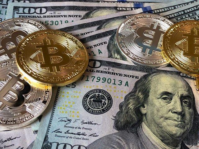 Pexels.com / Bitcoin and US Dollars