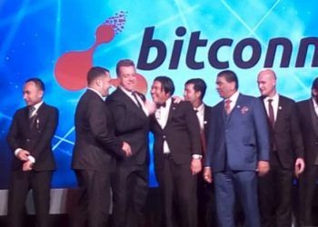 John Bigatton (fourth from left) at a BitConnect conference. Youtube Screenshot.