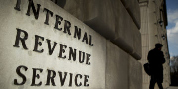 The Internal Revenue Service (IRS) headquarters strands in Washington, D.C., U.S., on Wednesday, April 9, 2014. The deadline for filing 2013 U.S. taxes is April 15. Photographer: Andrew Harrer/Bloomberg via Getty Images