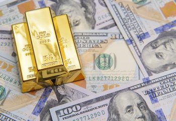 gold falls slightly as world economies reopen