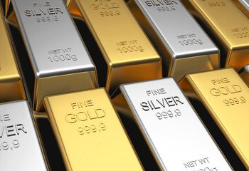 gold and silver slide as economies stabilize